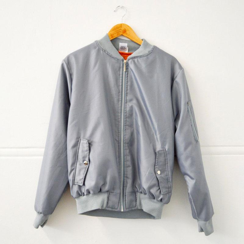 Grey aviation bomber jacket with orange inner lining